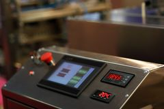 Touch screen control panel of industrial equipment stock photos