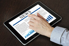 Touch screen device with business news Royalty Free Stock Photography