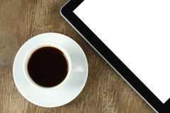 Touch screen device and cup of coffee Stock Photos
