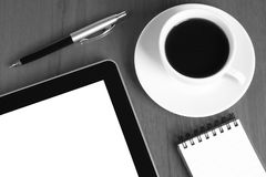 Touch screen device, notepad, pen and coffee cup Royalty Free Stock Photography