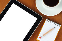 Touch screen device, notepad, pencil, coffe cup Stock Photo