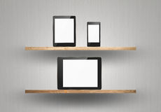Touch screen device on wood shelf Stock Photo