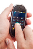 Touch-screen dialing. Finger dialing on touch-screen smart phone in hand isolated Stock Image