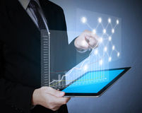 Touch screen graph on tablet in hands Stock Images