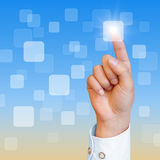 Touch screen and hand. Hand pushing a button on a touch screen interface Royalty Free Stock Photos