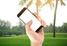 Touch screen in hand, tablet on golf club - soft blur background Royalty Free Stock Image