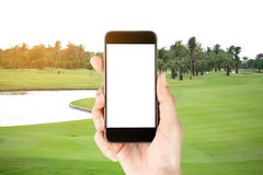 Touch screen in hand, tablet on golf club - soft blur background Stock Photo