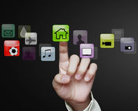 Touch screen interface. Hand pushing on a touch screen interface Stock Photography