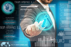 Touch screen interface. Finger of a business man pressing a touch screen interface Stock Image