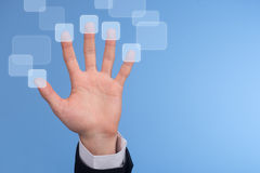 Touch screen interface. Hand pressed on the touch screen button Royalty Free Stock Photo