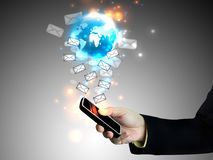 Touch screen mobile phone. Businessman holding touch screen mobile phone Stock Photo