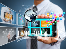 Touch screen mobile phone with businessman Stock Photos