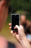 Mobile phone in hand Stock Photos