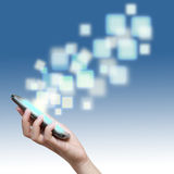 Touch screen of mobile phone with streaming images. On blue stock photo