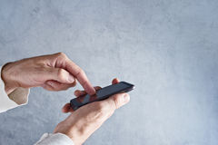 Touch screen mobile smart phone in male hands Royalty Free Stock Image