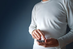 Touch screen mobile smart phone in male hands Stock Photo