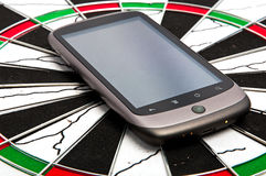 Touch screen phone. A touch screen cell phone on a dart board royalty free stock image