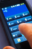 On touch screen phone. Dialing on touch screen smart phone royalty free stock photography
