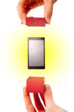 Touch screen phone present Royalty Free Stock Image