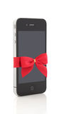 Touch Screen Smart Phone. With red ribbon and gift bow, isolated over white background stock image