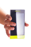 Touch screen smart phone with blank display in hand. Over white Royalty Free Stock Photos