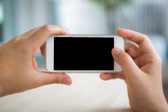Touch screen smart phone to do something . Hand touch the Screen on the Smart Phone stock photos