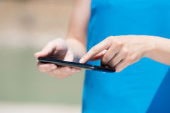 Touch screen smart phone. Unrecognized woman using touch screen smart phone in a close up shot royalty free stock image