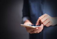 Touch screen smartphone in hand. Touch screen smartphone in a hand Stock Image