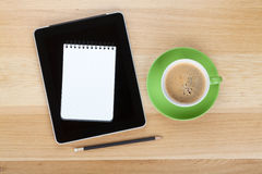 Touch screen tablet computer, notepad, pencil and cup of coffee Royalty Free Stock Image
