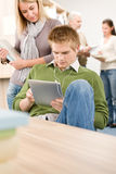 Touch screen tablet computer - students in library Royalty Free Stock Photos