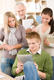 Touch screen tablet computer - students in library Stock Image