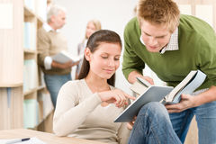 Touch screen tablet computer - students in library Royalty Free Stock Photo