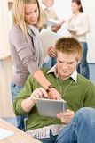 Touch screen tablet computer - students in library Stock Images