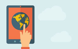 Touch screen tablet with the globe icon Stock Photos