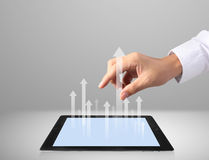 Touch screen tablet with graph Stock Photography