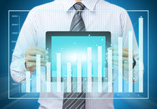Touch screen tablet with growth chart Royalty Free Stock Photos