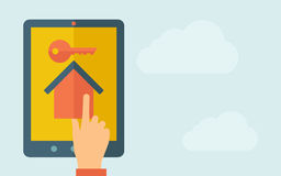Touch screen tablet with house and key icon Royalty Free Stock Photography