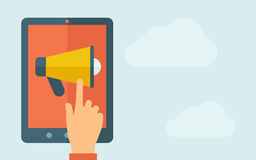 Touch screen tablet with the megaphone icon Stock Photo