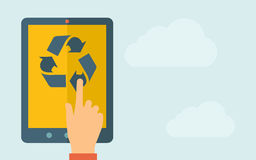 Touch screen tablet with the recycle icon Royalty Free Stock Photos
