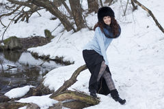 Touch of spring. Portrait of beautiful woman in a winter forest Stock Images