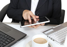 Touch tablet. Business man touch tablet working two notebook and hot coffee on white table Royalty Free Stock Photo