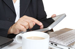 Touch tablet. Business man touch tablet working notebook and hot coffee on white table Stock Photography