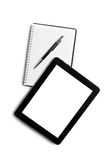 Touch tablet and blank notebook Royalty Free Stock Photo