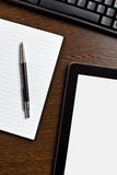 Touch tablet and blank paper Royalty Free Stock Photography