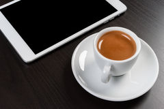 Touch tablet and coffee. On office table Stock Photos