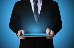 Touch- tablet in hands Business man Royalty Free Stock Photo