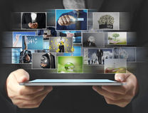 Touch- tablet in hands Royalty Free Stock Photography