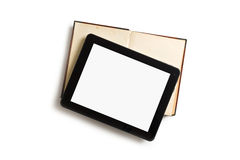Touch tablet with old book Royalty Free Stock Photography