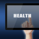 Touch the Tablet with text Health Stock Images