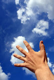 Touch to The Sky. Man hand touch to the fine clouds in the sunny sky. It possible Royalty Free Stock Photos
